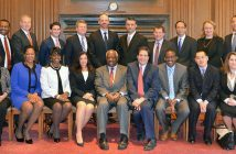 Fordham Law alumni surround Supreme Court Justice Clarence Thomas (seated, sixth from left) and Dean Matthew Diller (seated, fifth from right)