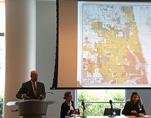 "David Bryan (far left), director of Brooklyn A's Consumer and Economic Advocacy Program, illustrates how the practice of ""redlining"" in Chicago districts featuring African-Americans and Latinos has not changed much since the 1930s."