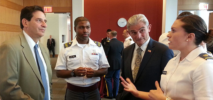 Cadets speak with Fordham Law Dean Matthew Diller (left) and alumnus Michael Nardotti '76 (second from right).