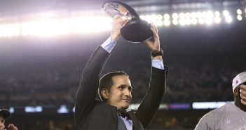 Howie Roseman, Philadelphia Eagles executive vice president of football operations, lifts the NFC championship trophy after the Eagles' 38-7 win over the Minnesota Vikings during the NFC championship NFL football game Sunday, Jan. 21, 2018, in Philadelphia. (David Maialetti/The Philadelphia Inquirer via AP)