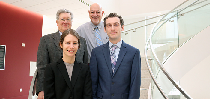 Erin Shahinfar and Christopher Clark, with Professors Jay Rubin and Gerald Lebovits behind.