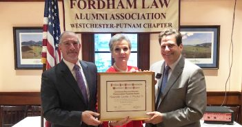 Chapter President Edward J. Guardaro Jr. '85, Hon. Loretta A. Preska '73, and Matthew Diller