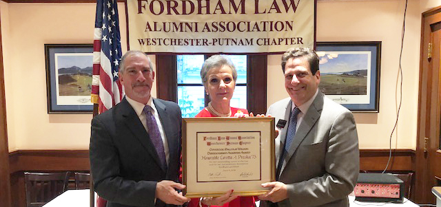 Chapter President Edward J. Guardaro Jr. '85, Hon. Loretta A. Preska '73, and Matthew Diller
