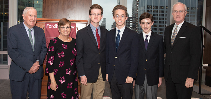 Robert J. Reilly '75 (far right) with family and John D. Feerick '61 (far left)